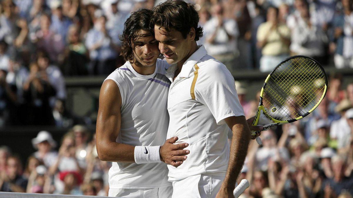 TENNIS 2007 Wimbledon Rafael Nadal versus Roger Federer hug centre court final (Reuters)