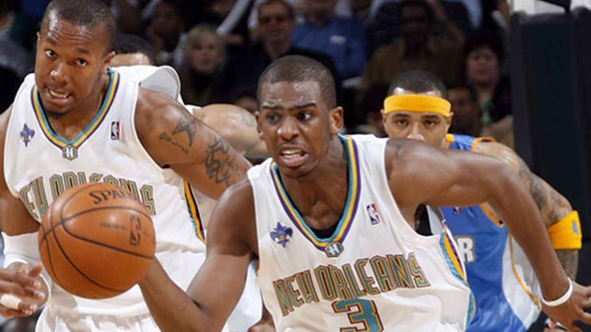 BASKETBALL Chris Paul #3 of the New Orleans Hornets drives against the Denver Nuggets