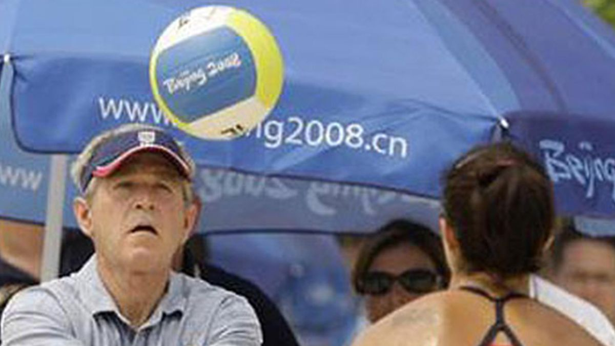 BEACH VOLLEY US President George Bush practices with US beach volleyball player Misty MayTreanor Beijing 2008