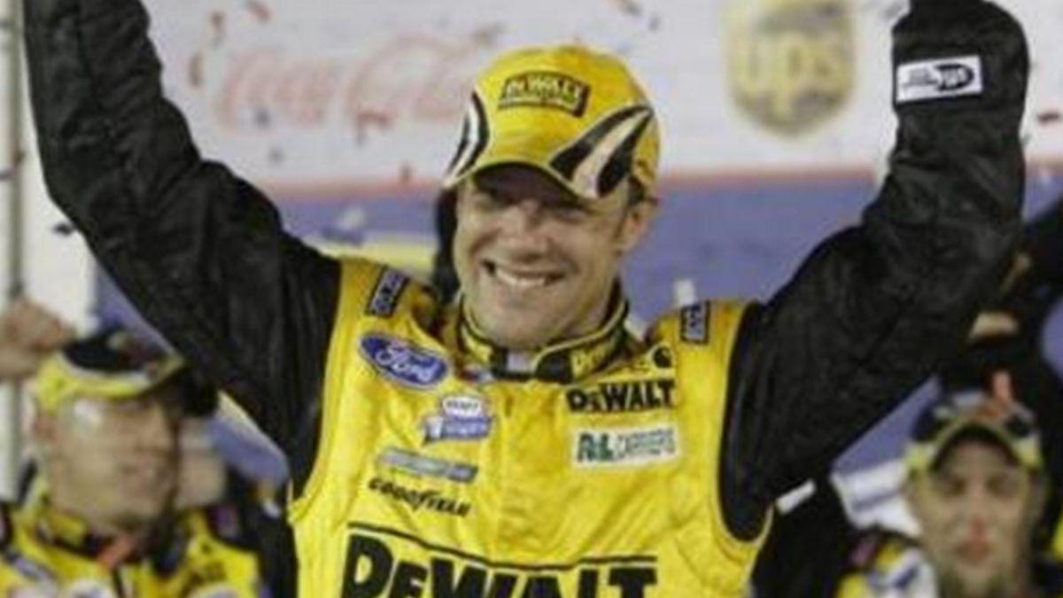 Matt Kenseth celebrates in victory lane after winning the rain-shortened NASCAR Daytona 500