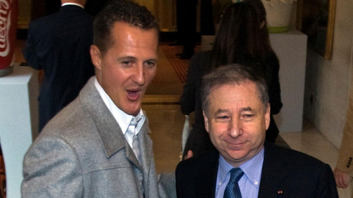 Former Ferrari team boss Jean Todt (R) and former Ferrari Formula One driver Michael Schumacher of Germany arrive for a meeting with Formula One's governing body in Paris, REUTERS