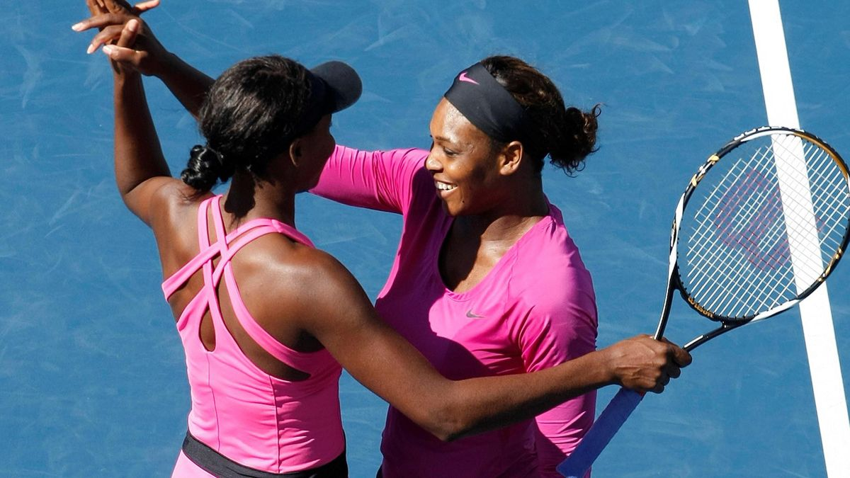 Serena (R) and Venus Williams of the U.S. celebrate winning the women's doubles at the US Open, REUTERS