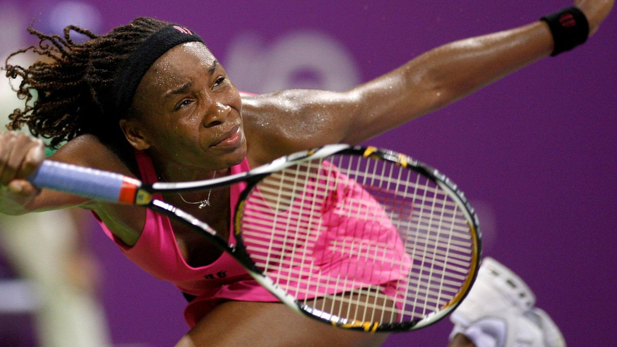 Venus Williams of the US hits a return to Svetlana Kuznetsova of Russia during the WTA Tour Championships, REUTERS