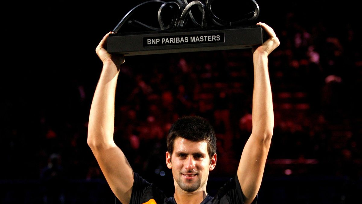Novak Djokovic of Serbia poses with his trophy after defeating Gael Monfils of France in their final match of the Paris Masters