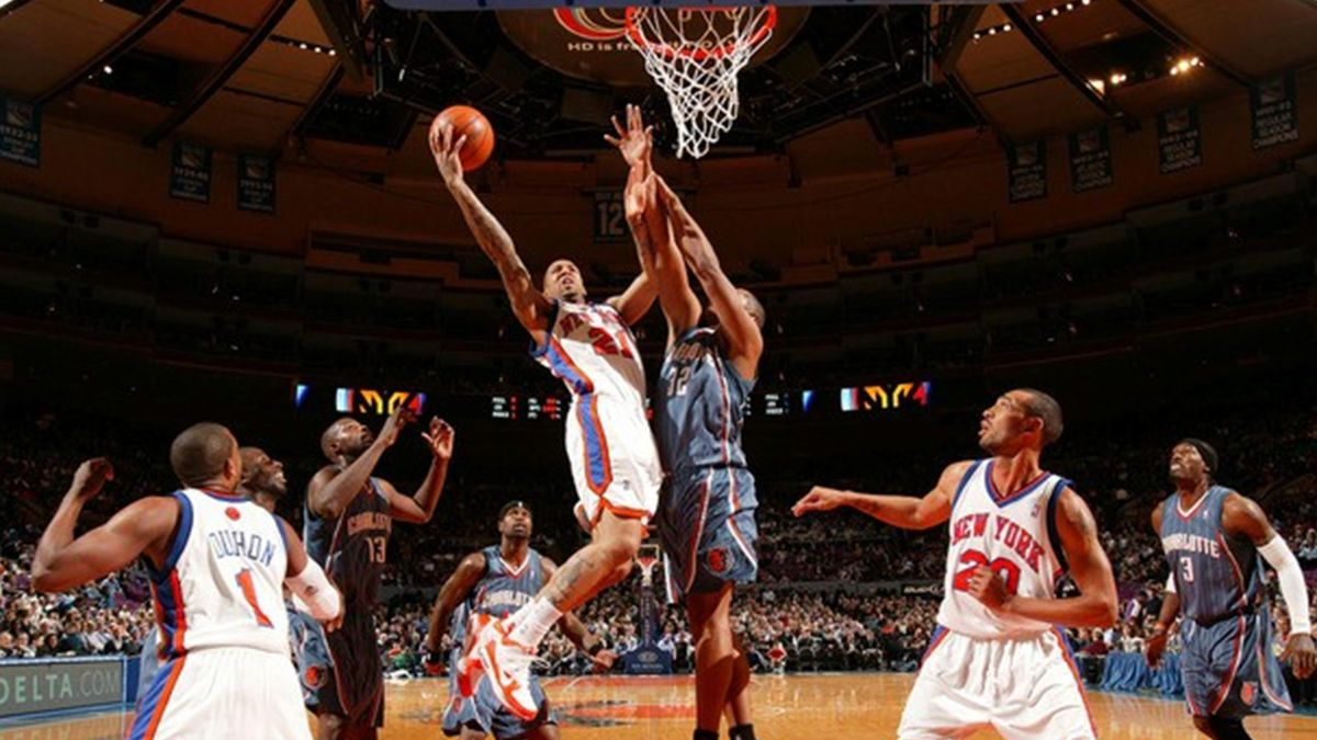 Wilson Chandler(notes) #21 of the New York Knicks shoots against Boris Diaw(notes) #32 of the Charlotte Bobcats