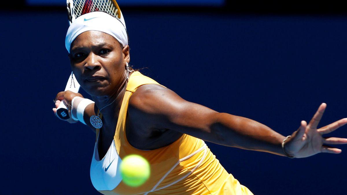 Serena Williams of the U.S. hits a return against Poland's Urszula Radwanska during the Australian Open