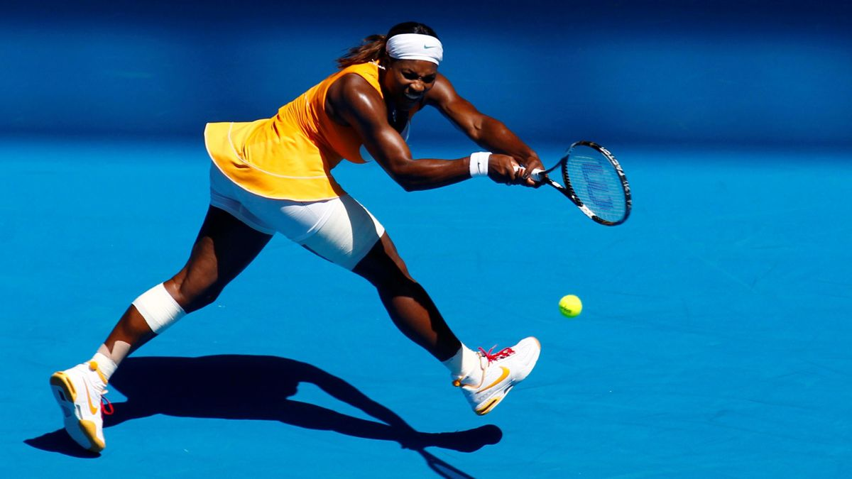 Serena Williams of the U.S. returns a shot against Carla Suarez Navarro of Spain at the Australian Open
