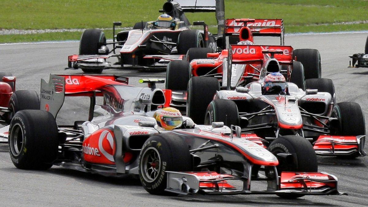 McLaren Formula One driver Hamilton and teammate driver Button drive during the Malaysian F1 Grand Prix at Sepang circuit