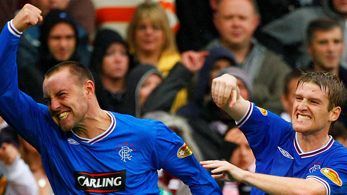 Rangers' Kris Boyd (L) celebrates with his team mate Steven Davis
