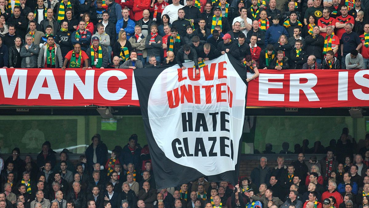Manchester United fans hold up hate Glazer protest banners in the stands against the clubs current owners