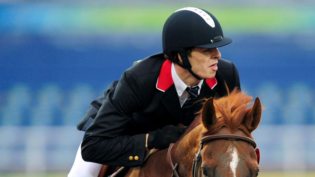 Modern Pentathlon competitor Sam Weale of Britain jumps on a horse