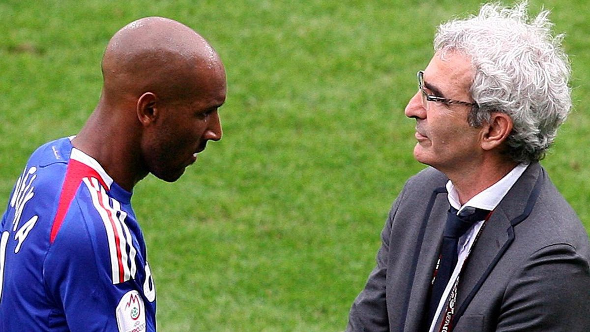 French Nicolas Anelka (L) shakes hands with French soccer coach Raymond Domenech (R) during the EURO 2008 preliminary round group C match between France and Romania at the Letzigrund stadium in Zurich, Switzerland 09 June 2008