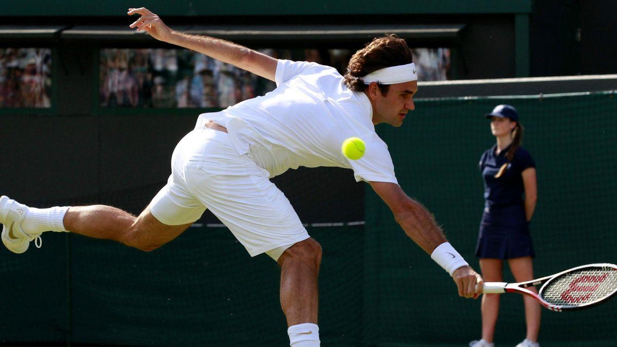 Switzerland's Roger Federer hits a return to Serbia's Ilija Bozoljac at Wimbledon