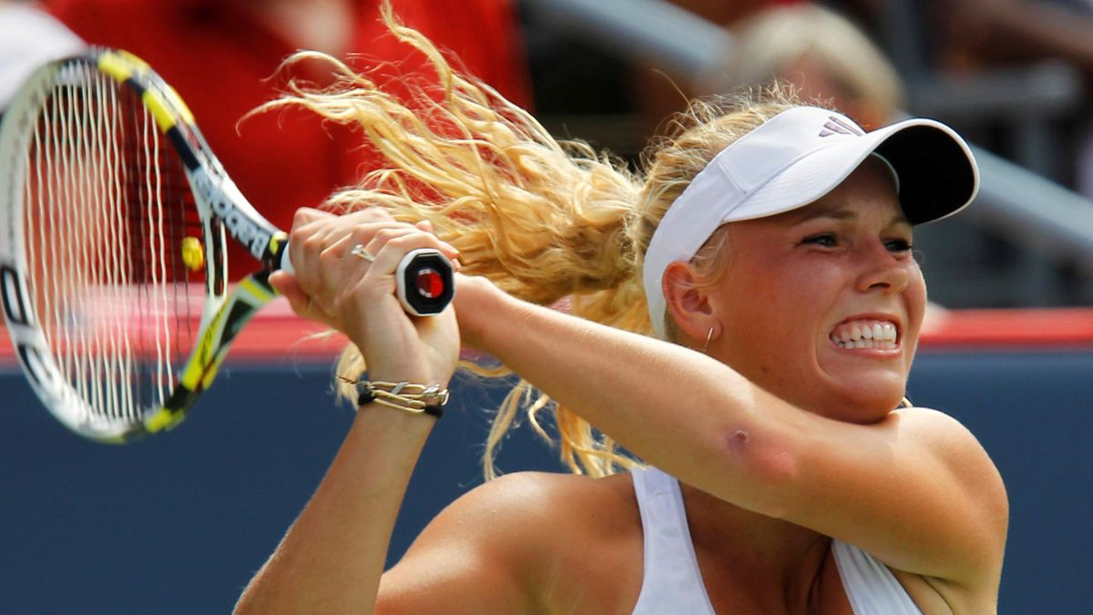 Caroline Wozniacki of Denmark returns a shot to Patty Schnyder of Switzerland at the Rogers Cup tennis tournament in Montreal