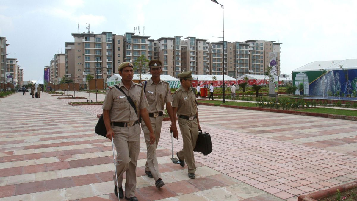ndian policemen walk inside the 2010 Commonwealth Games athletes village in New Delhi