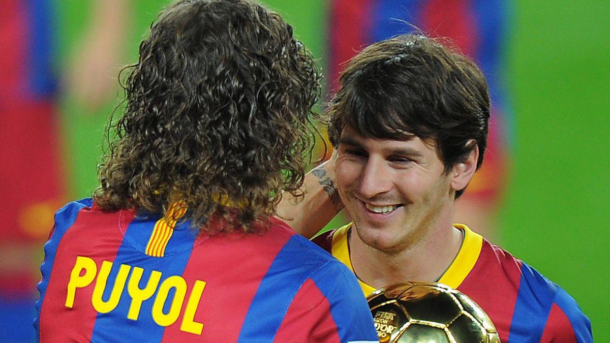 Puyol y Messi con el Balón de Oro (AFP)