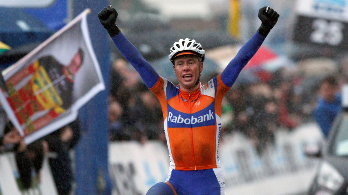 Rabobank team rider Sebastian Langeveld of the Netherlands celebrates at the finish line as he wins the Omloop Het Nieuwsblad