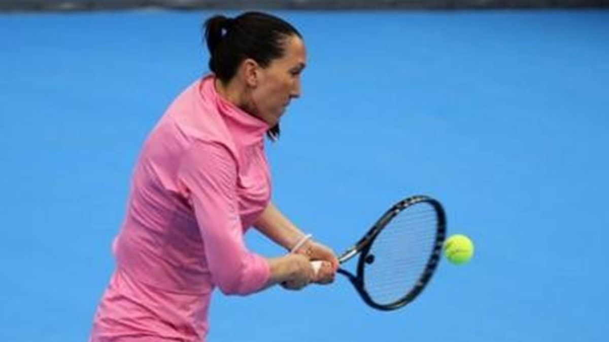 Serbia's Jelena Jankovic returns the ball to Slovenia's Polona Hercog