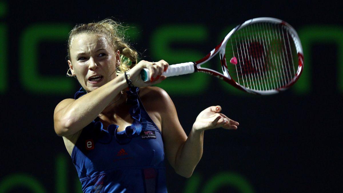 Caroline Wozniacki of Denmark follows through on a return