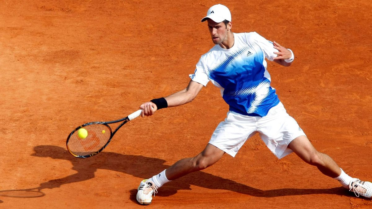 Novak Djokovic of Serbia returns the ball to Roger Federer of Switzerland during their semi-final match in the Monte Carlo Masters Series tennis tournament in Monaco April 26, 2008. Federer reached the final after Djokovic retired.