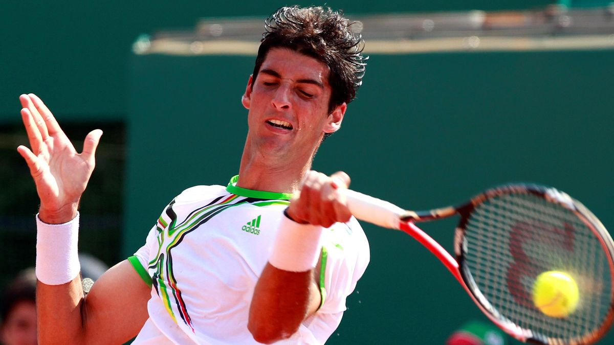 homaz Bellucci of Brazil returns the ball to Gilles Simon of France during the Monte Carlo Masters