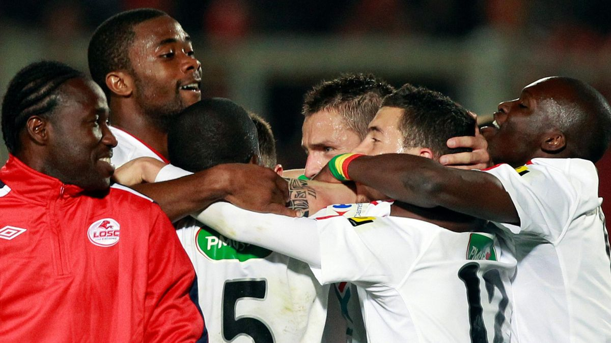 Lille's players celebrate their French Cup semi-final soccer match victory over Nice at Le Ray stadium in Nice