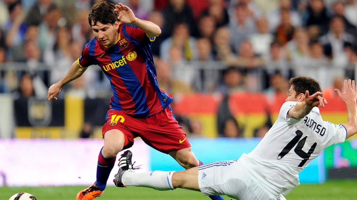 2010-11 Champions League Barcelona's Lionel Messi fouled by Real Madrid's Xabi Alonso