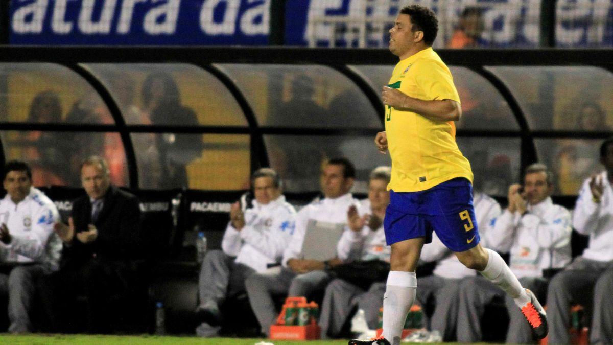 Brazil's Ronaldo runs on the field during his last soccer match with the national squad against Romania in Pacaembu Stadium in Sao Paulo