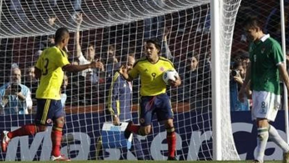 Colombia's Radamel Falcao, center, celebrates with teammate Freddy Guarin, left, after scoring during a Copa America Group A. soccer match against Bolivia in Santa Fe, Argentina