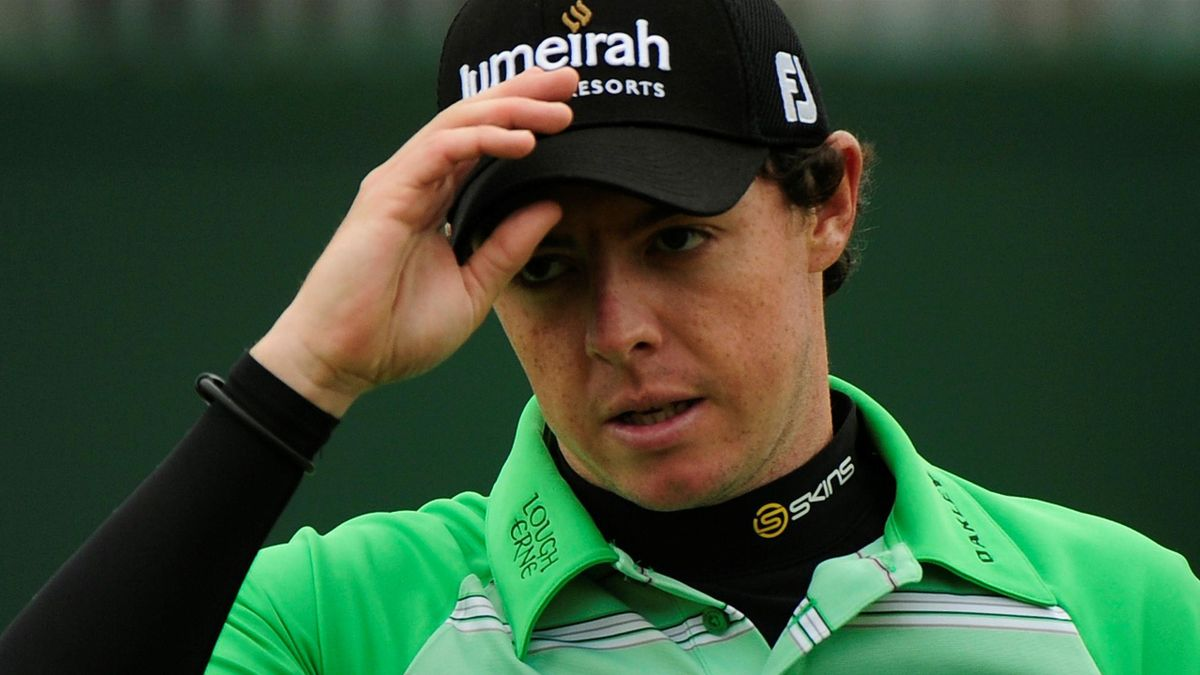 Rory McIlroy of Northern Ireland tips his cap as he walks off the 18th green after finishing his third round of the British Open golf championship at Royal St George's in Sandwich, southern England July 16, 2011