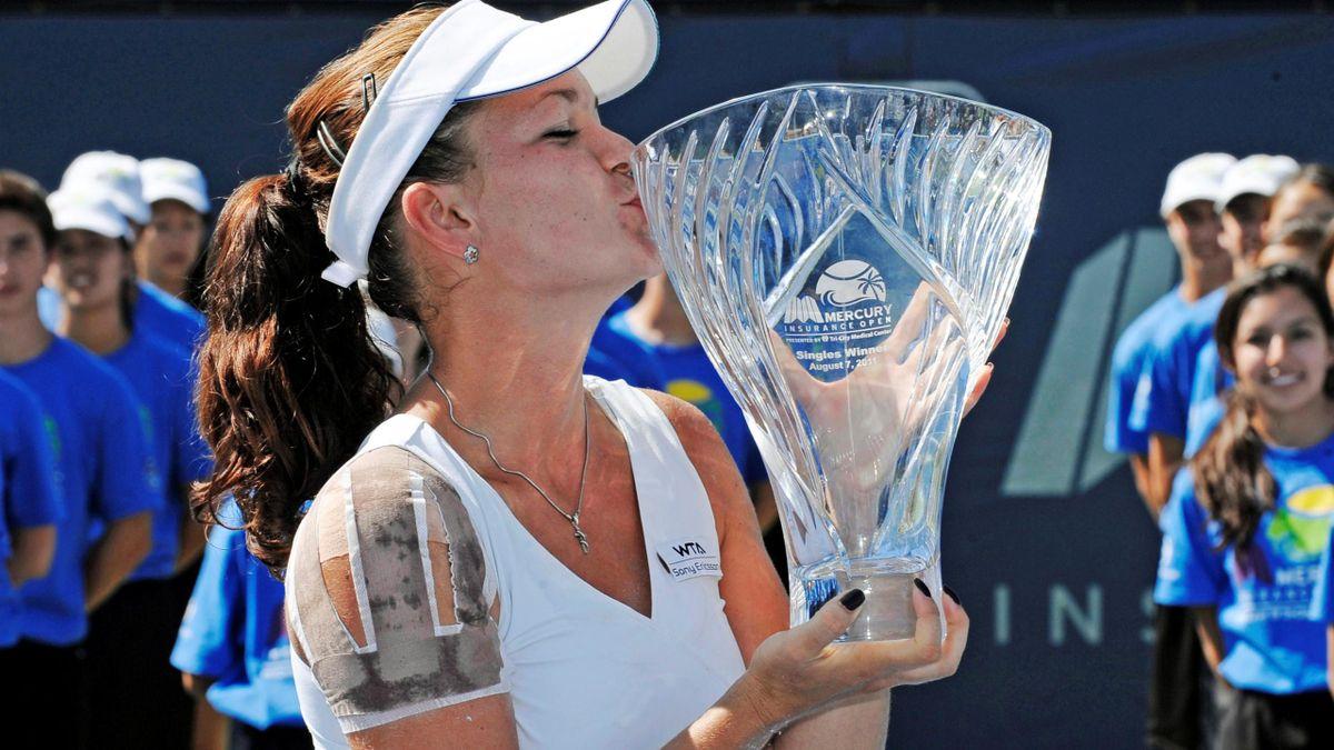 Agnieszka Radwanska of Poland kisses the trophy after winning her final match against Vera Zvonareva of Russia at a WTA tennis event in Carlsbad, California August 7, 2011