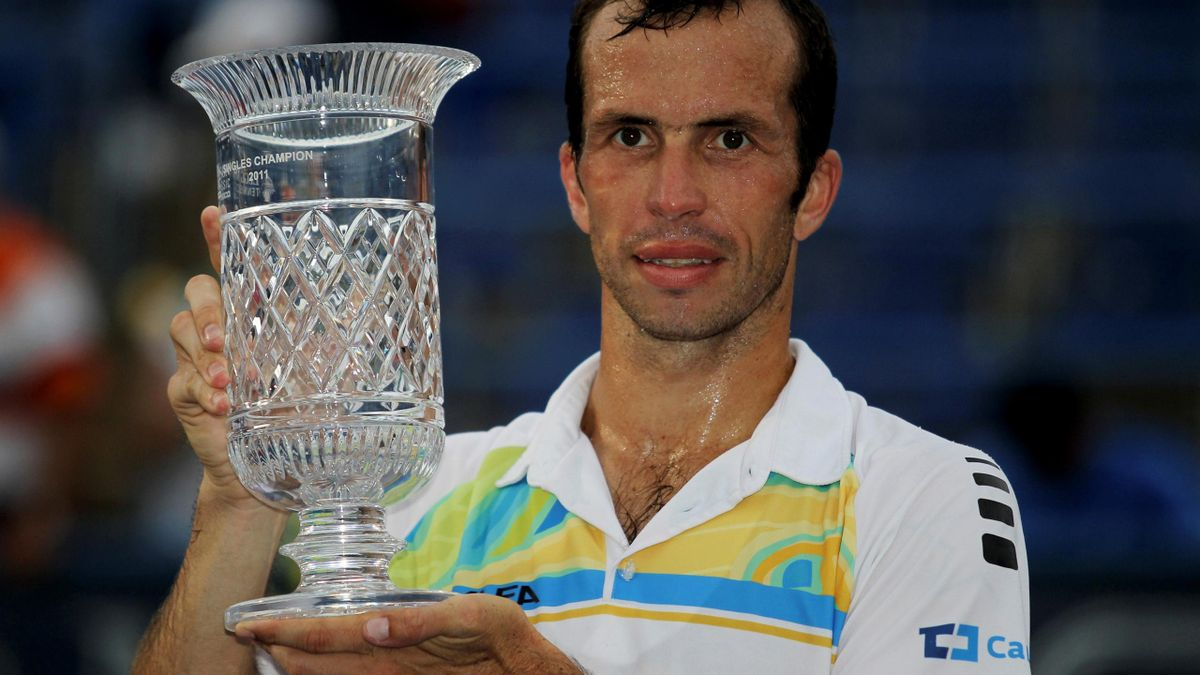 Radek Stepanek of Czech Republic holds up his trophy after defeating Gael Monfils of France in the final match at the Legg Mason Tennis Classic in Washington August 7, 2011
