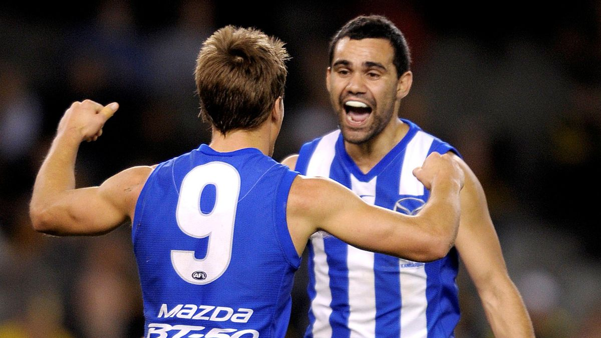 AUSTRALIAN RULES FOOTBALL Andrew Swallow and Lindsay Thomas of North Melbourne celebrate kicking a goal against Richmond during their Round 24 AFL game at the Etihad Stadium in Melbourne, Sunday, Sept. 4 (AAP Australia only)
