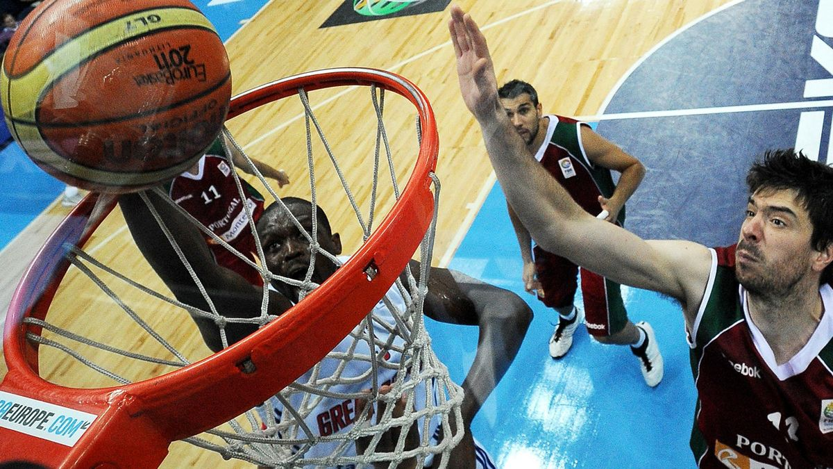 Luol Deng of Great Britain scores against Portugal