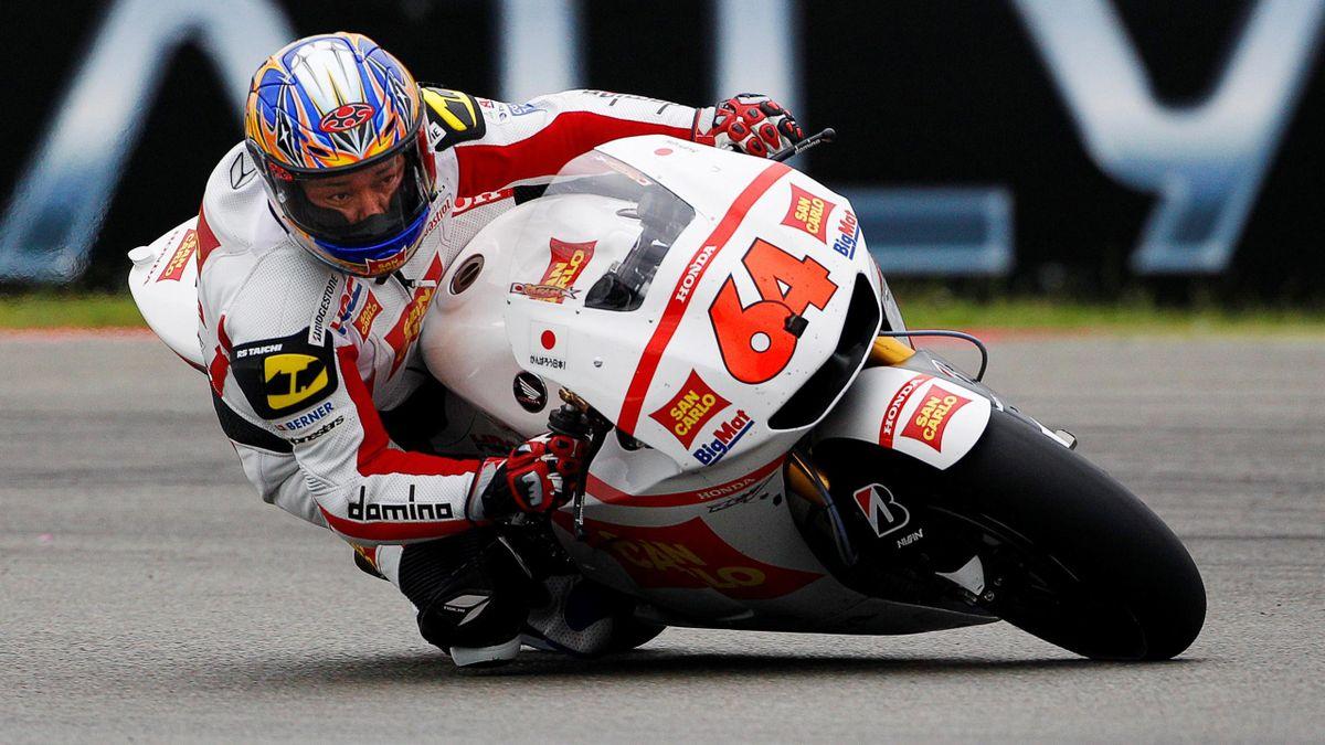 Honda MotoGP rider Kousuke Akiyoshi of Japan cuts a corner during the MotoGP race of the Grand Prix in Assen June 25, 2011.