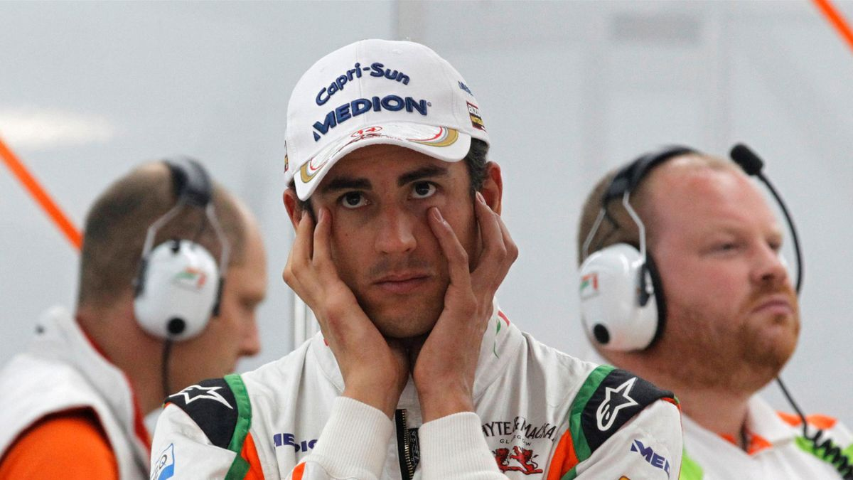 Sahara Force India Formula One driver Adrian Sutil of Germany covers his ears during the first practice session of the South Korean F1 Grand Prix at the Korea International Circuit in Yeongam October 14, 2011