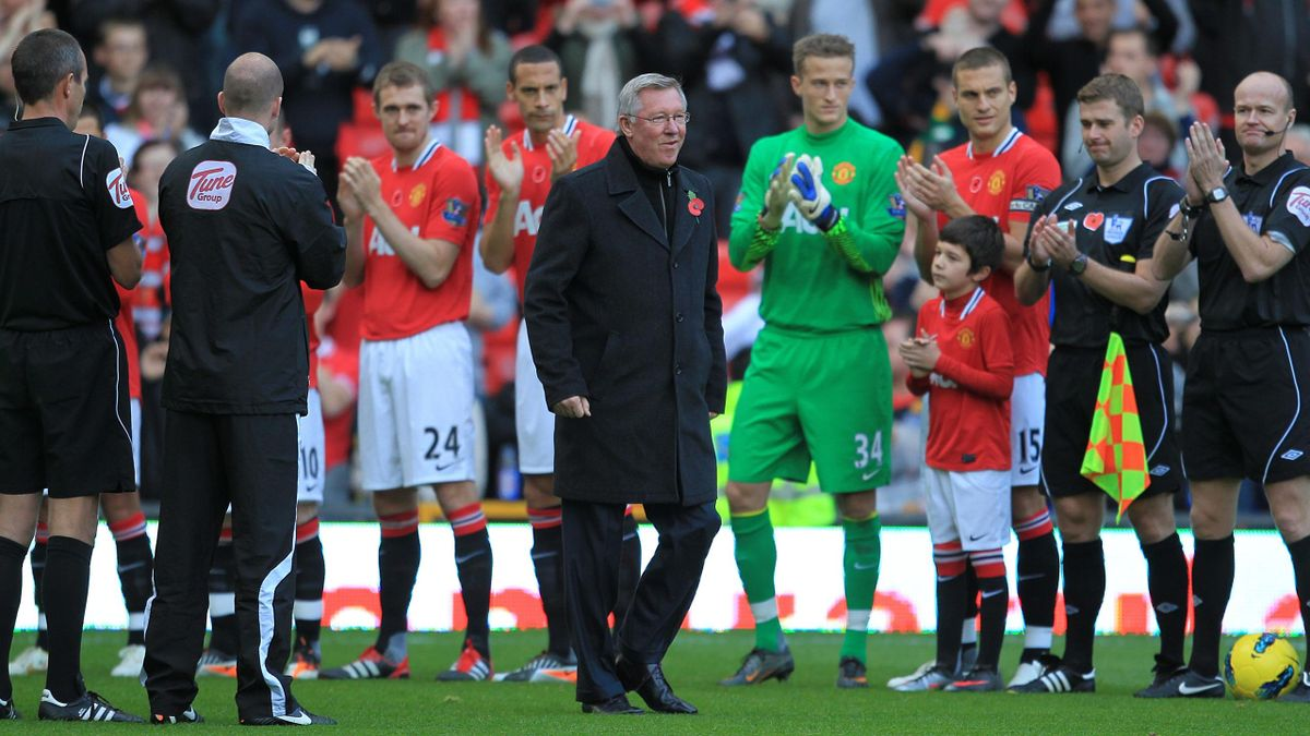 Manchester United manager Sir Alex Ferguson is given a guard of honour as he celebrates 25 years at the club