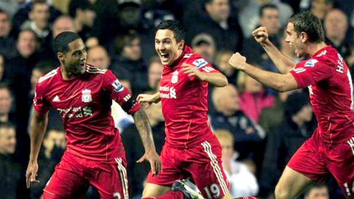 Liverpool's Glen Johnson (L) celebrates with team mates Stuart Downing (C) and Jordan Henderson after scoring a goal against Chelsea during their English Premier League soccer match at Stamford Bridge in London November 20, 2011.