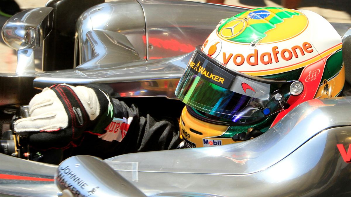 McLaren Formula One driver Lewis Hamilton wears his new helmet, painted with the Brazilian flag