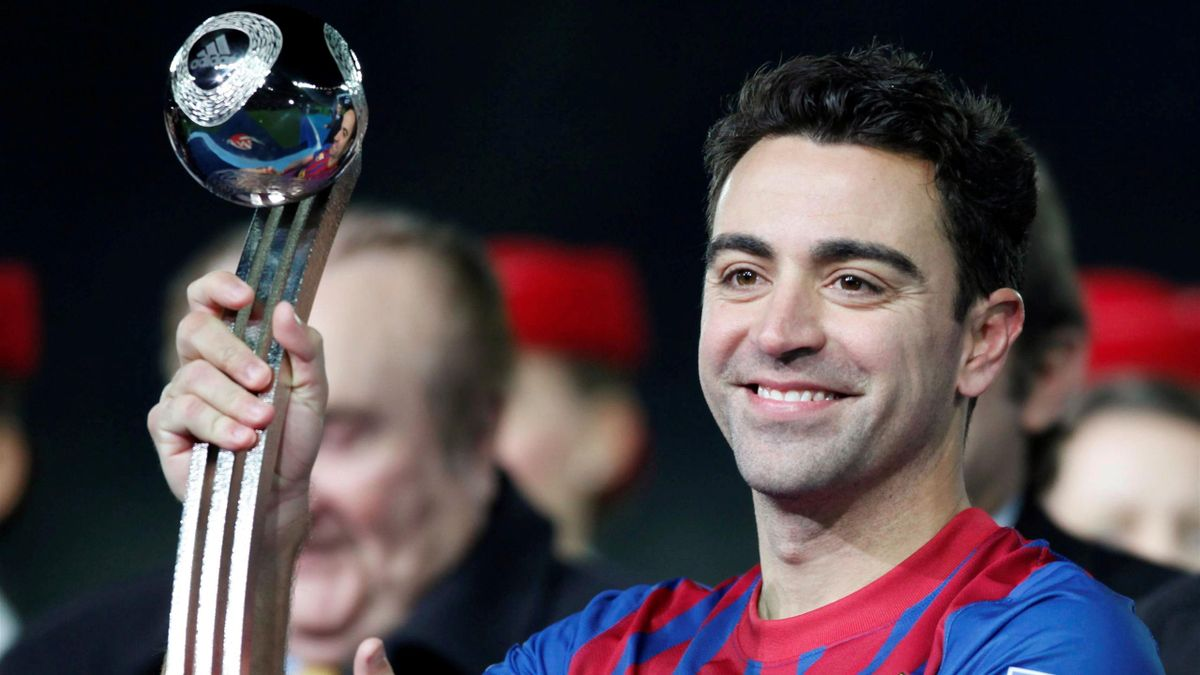 Xavi of Spain's Barcelona holds the trophy for second best player