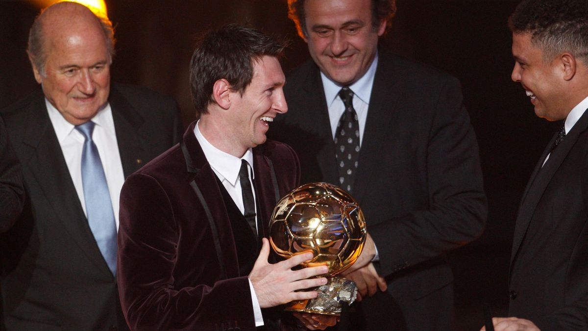 FOOTBALL Lionel Messi (central) receives the Ballon d'Or award from Ronaldo (right), Michel Platini (background) and Sepp Blatter (left) on January 9