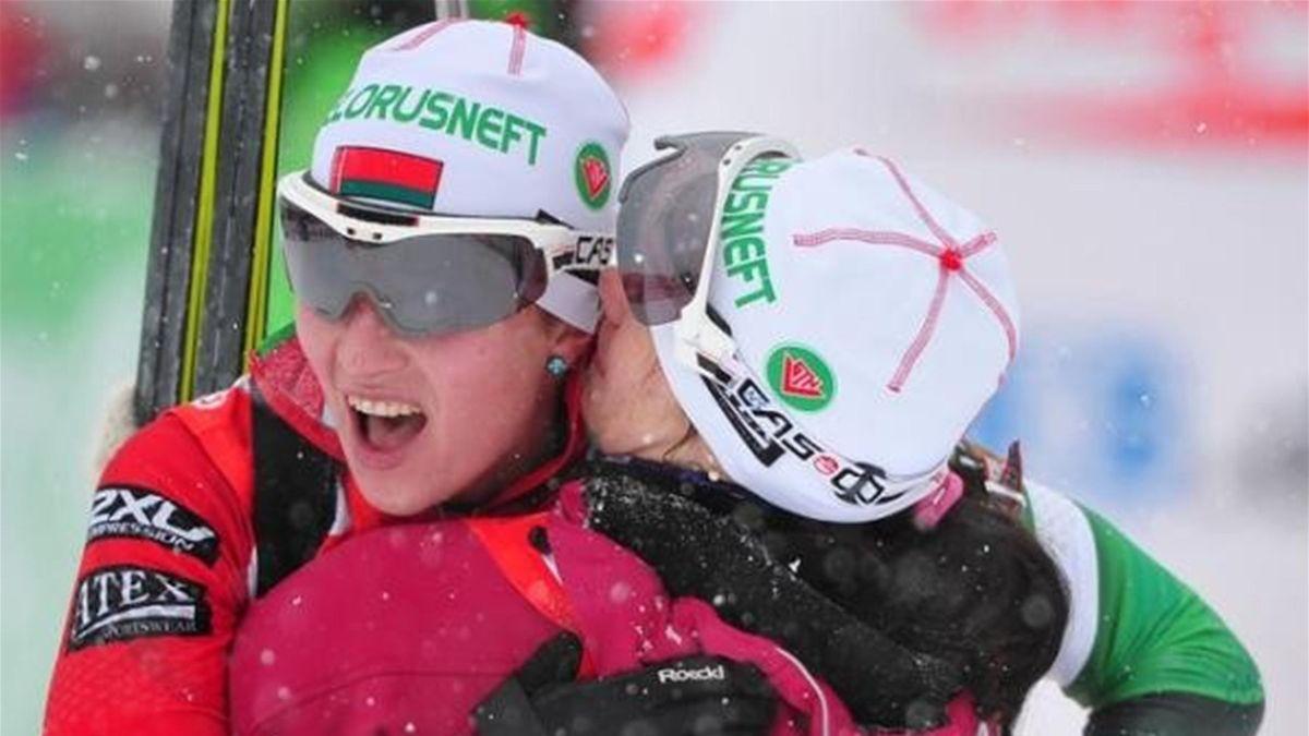 Belarus Darya Domracheva (L) is embraced by teammate Nastassia Dubarezava