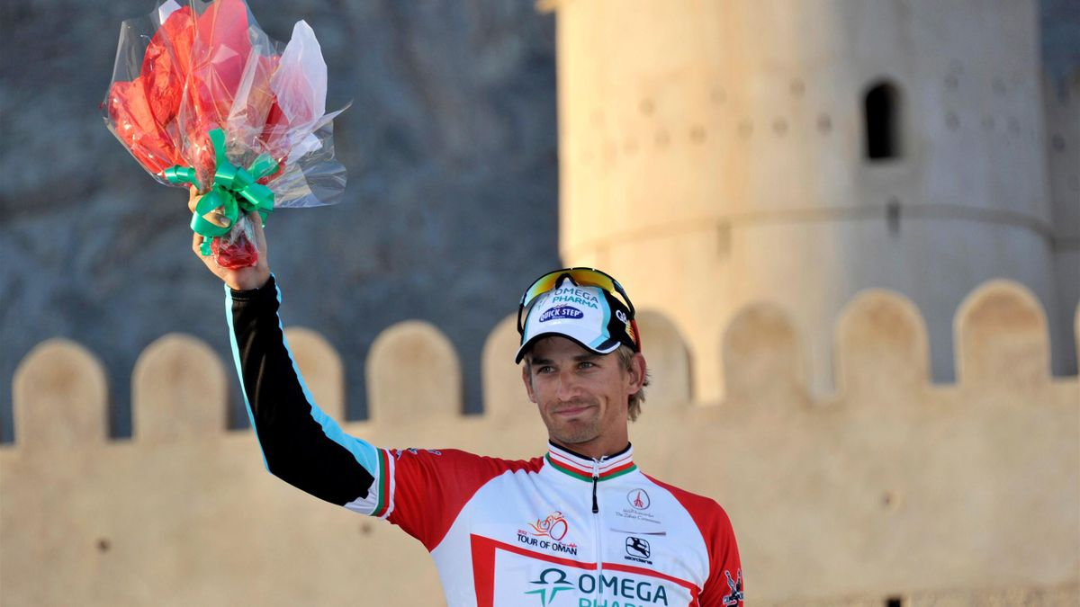 Peter Velits of Slovakia of Omega Pharma Quick Step celebrates winning the red jersey and placing second in the fifth stage of the third Tour of Oman cycling race, which runs a distance of 158 km from Royal Opera House in Wilayat Boshar to al-Jabal al-Akh