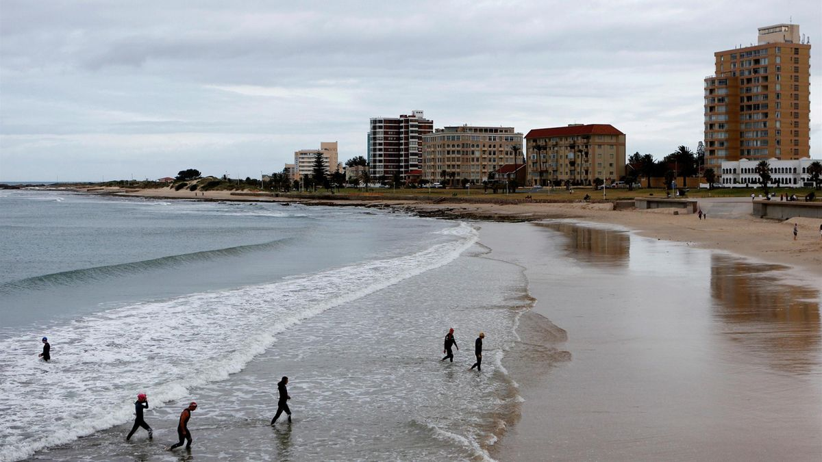 Visitors leave a beach after a swimming exercise in Port Elizabeth