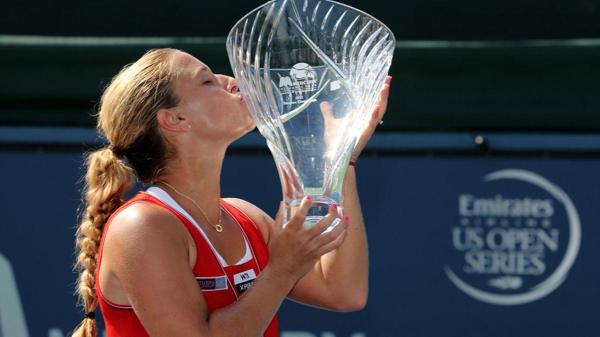 Dominika Cibulkova of Slovakia kisses the trophy after defeating Marion Bartoli of France