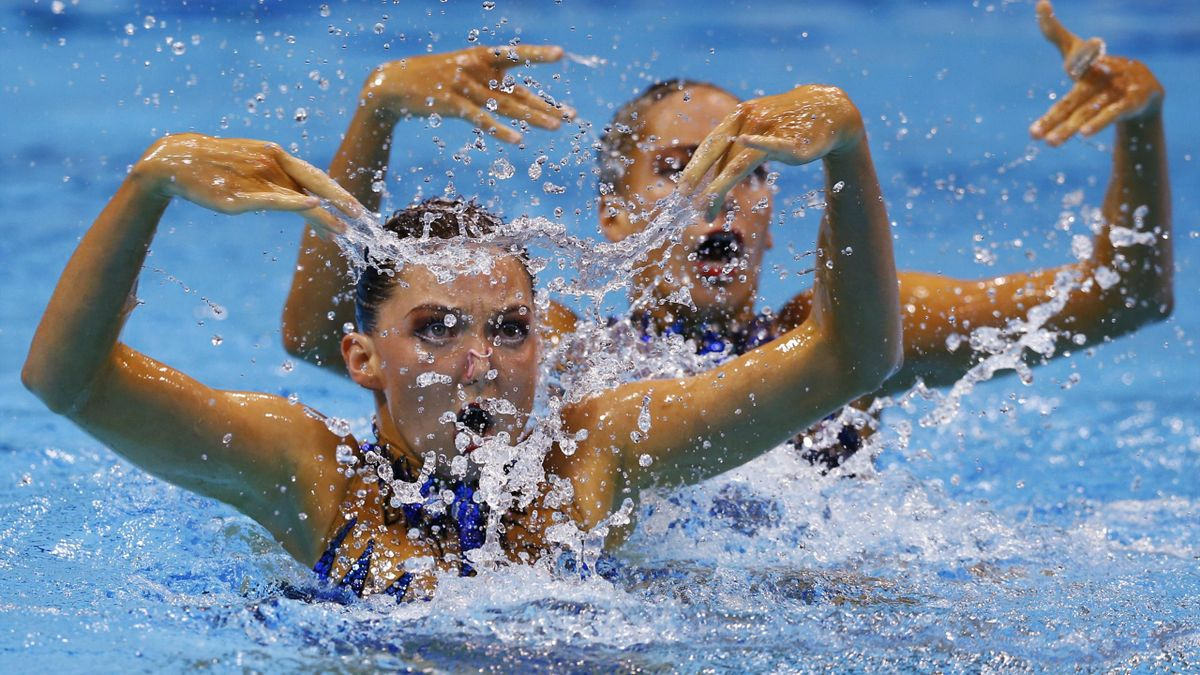 Britain's Olivia Federici and Jenna Randall perform in the synchronised swimming duets final during the London 2012 Olympic Games at the Aquatics Centre August 7, 2012.