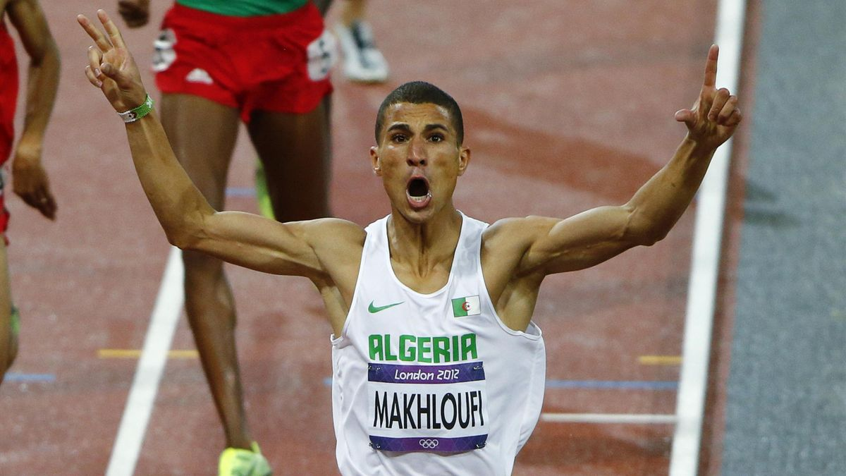 Algeria's Taoufik Makhloufi celebrates as he wins the men's 1500m final during the London 2012 Olympic Games at the Olympic Stadium
