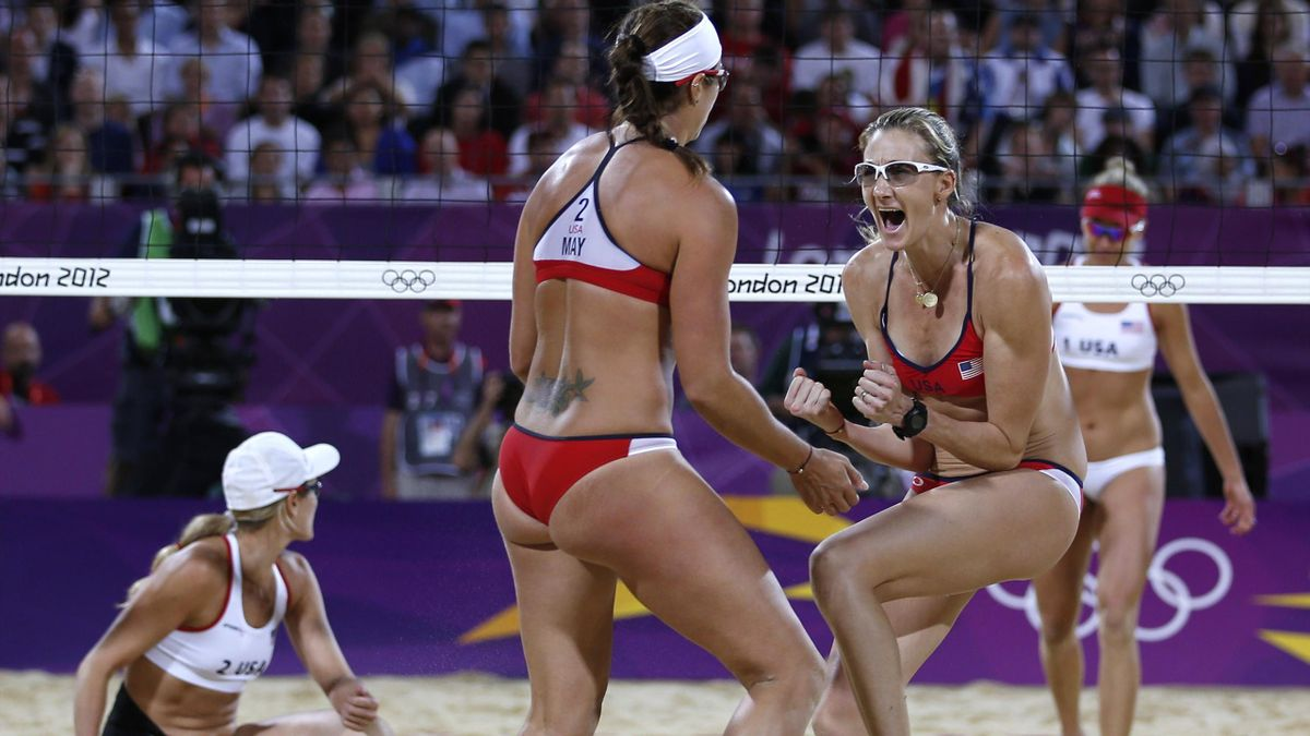 Misty May-Treanor of the U.S. and team mate Kerri Walsh Jennings (R) celebrate a point at the women's beach volleyball gold medal match at the Horse Guards Parade during the London 2012 Olympic Games August 8, 2012.