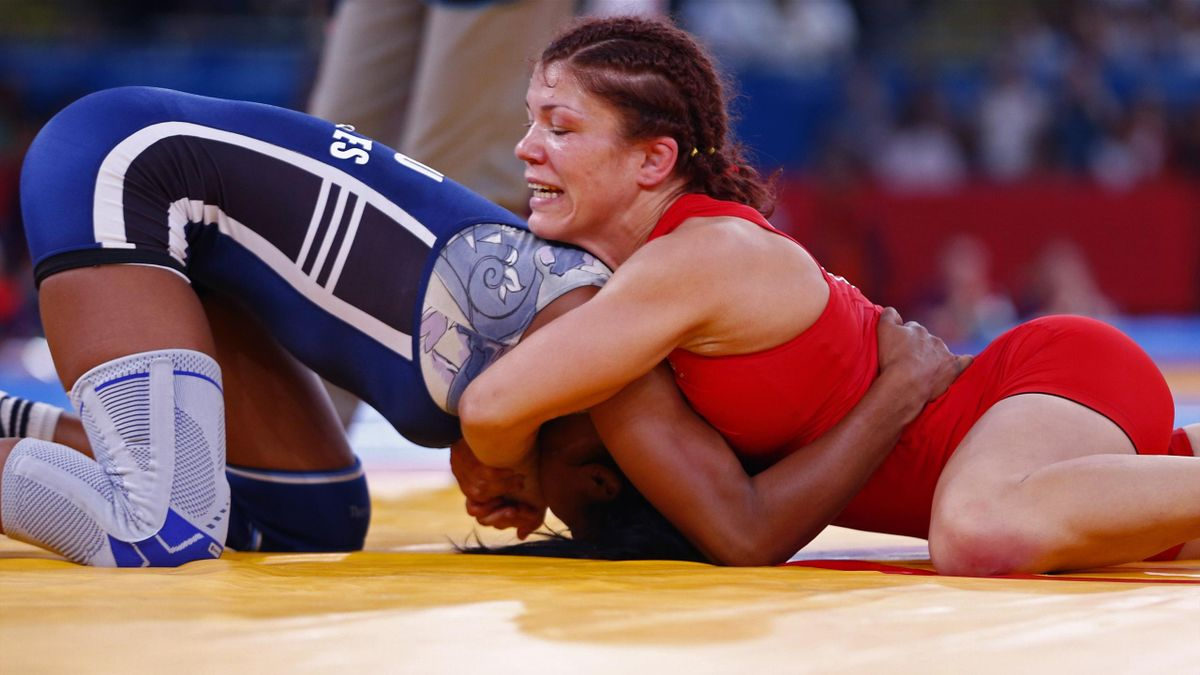 Great Britain's Olga Butkevych (in red) fights with Ecuador's Lissette Antes Castillo on the Women's 55Kg Freestyle wrestling at the ExCel venue during the London 2012 Olympic Games (Reuters)