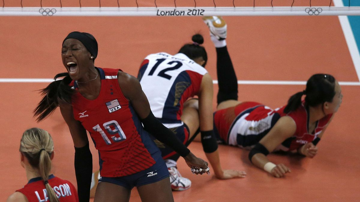 Destinee Hooker (2nd L) and Jordan Larson of the U.S. celebrate a point against South Korea during their women's semi-final volleyball match at Earls Court during the London 2012 Olympic Games (Reuters)